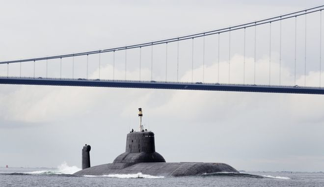 "The Russian nuclear submarine ""Dmitrij Donskoj"" passes through the Great Belt strait near Korsoer, Denmark along with three other Russian warships, Friday, July 21, 2017. The vessels are on their way to St. Petersburg to attend the annual Navy Day on Sunday according to the Independent Barents Observer. (Nanna Navntoft/Ritzau Foto via AP)"