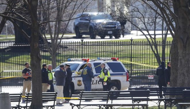 Law enforcement officers gather infront of the White House in Washington, after the area was closed to pedestrian traffic, Saturday, March 3, 2018. A man apparently shot himself along the north fence of the White House midday, according to the Secret Service, which also said he was being treated for the wound. (AP Photo/Pablo Martinez Monsivais)