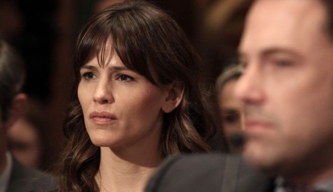 Actress Jennifer Garner listens to testimony on Capitol Hill in Washington, Thursday, March 26, 2015, during a Senate State, Foreign Operations, and Related Programs subcommittee hearing on diplomacy, development and national security, where her husband, Ben Affleck, right, testified. (AP Photo/Lauren Victoria Burke)