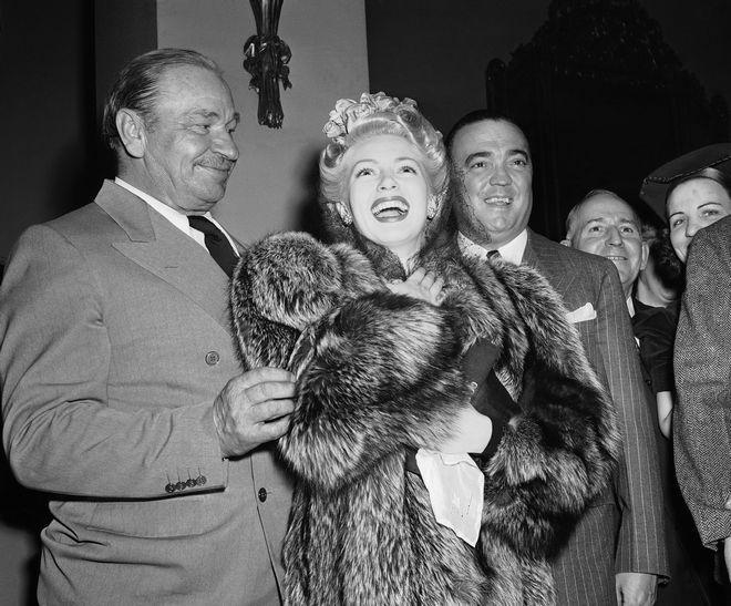J. Edgar Hoover, director of the FBI, actress Lana Turner, actor Wallace Beery, in Washington, Jan. 29, 1941. (AP Photo)
