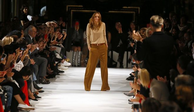Designer Stella McCartney accepts applause at the end of her Spring/Summer 2018 ready-to-wear fashion collection presented in Paris, Monday, Oct. 2, 2017. (AP Photo/Francois Mori)