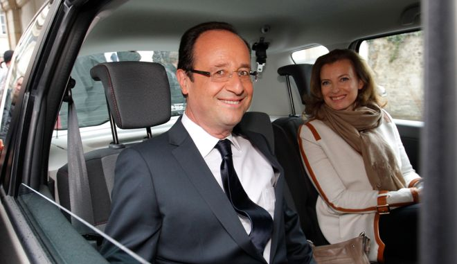 Francois Hollande (L), Socialist Party candidate for the 2012 French presidential election, and his companion Valerie Trierweiler sit in a car as they leave a polling station in Tulle during the second round of the 2012 French presidential election May 6, 2012. Voting started in mainland France on Sunday in the runoff presidential elections.   REUTERS/Stephane Mahe (FRANCE - Tags: POLITICS ELECTIONS)