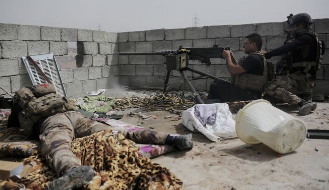 In this Monday, April 24, 2017 photo, Iraqi Special Forces fire at Islamic State positions in western Mosul. The spokesman for the ministry of defense said Thursday, May 4, 2017, that Iraqi forces have begun a push along the northern edge of Mosul's western half where Islamic State group fighters are holding onto a cluster of neighborhoods. The front lines in western Mosul have inched forward for months as IS fighters have used a claustrophobic battle space and hundreds of thousands of civilians as human shields to slow Iraqi troops. (AP Photo/Bram Janssen)