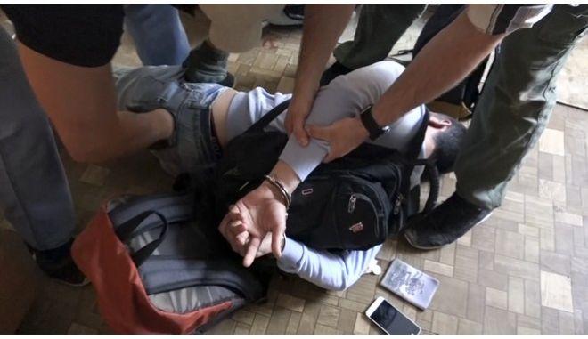 In this undated video grab provided by the RU-RTR Russian television via APTN on Monday, Aug. 14, 2017, Russian FSB officers arrest a man on suspicion of plotting a series of attacks outside Moscow, Russia. Russia's main intelligence agency said on Monday it has foiled a plot led by two Soviet-born militants fighting for the Islamic State group in Syria. The FSB did not say when the arrests took place. (RU-RTR Russian Television/ APTN via AP)