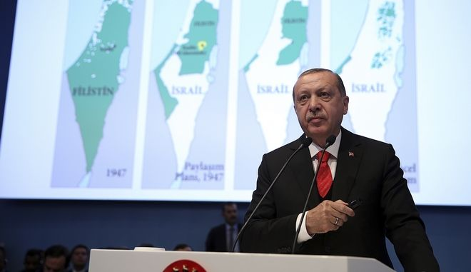 Backdropped by a map of Israel and Palestine, Turkey's President Recep Tayyip Erdogan addresses the Organisation of Islamic Cooperation's Extraordinary Summit in Istanbul, Wednesday, Dec. 13, 2017. The Istanbul gathering of heads of state and top officials from the 57-member Organisation of Islamic Cooperation could offer the Muslim world's strongest response yet to U.S. President Donald Trump's recognition of Jerusalem as the capital of Israel. (Kayhan Ozer/Pool Photo via AP)