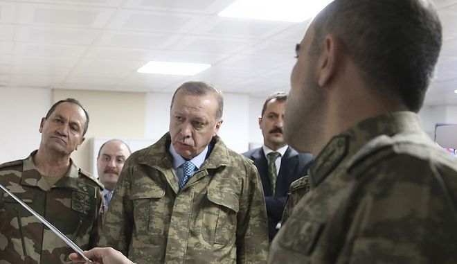 urkey's President Recep Tayyip Erdogan, second left, is briefed by a Turkish Army officer at the command center at the command center in Hatay province, Turkey at the border with Syria, Thursday, Jan. 25, 2018.  Erdogan has traveled to Turkey's border with Syria where he is being briefed on Turkey's military offensive against the Syrian Kurdish-held enclave of Afrin. (Pool Photo via AP)