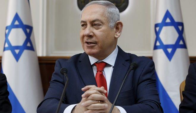 Israeli Prime Minister Benjamin Netanyahu opens the weekly cabinet meeting at his Jerusalem office Sunday Jan. 21, 2018. (Gali Tibbon/Pool via AP)