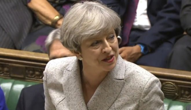In this grab taken from video, Britain's Prime Minister Theresa May speaks in the House of Commons, London, during its first sitting since the election, Tuesday June 13, 2017. Britain's prime minister has opened talks with a Northern Ireland-based party Tuesday to see if they can create an alliance to push through the Conservative Party's agenda after a disastrous snap election left her short of a majority in Parliament. (PA via AP)