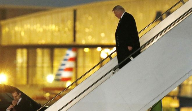 President-elect Donald Trump walks down the stairs from his plane after returning from Wisconsin to LaGuardia Airport, Tuesday, Dec. 13, 2016, in New York. (AP Photo/Kathy Willens)