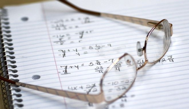 This photo taken March 12, 2014, shows a student's glasses sitting on a notebook containing math exercises in a remedial mathematics course at Baltimore City Community College in Baltimore. Only about a quarter of students nationally who take developmental _ or remedial _ classes ever graduate. The problem is so profound that the advocacy group Complete College America dubs remedial classes the bridge to nowhere. The challenge, educators say, is that even as billions is spent annually on remedial classes, many of these students run out of financial aid before they can complete their credit requirements, get discouraged by non-credit classes or find themselves unable to complete them. The Baltimore school is one of several places around the country looking to improve the odds for these students. (AP Photo/Patrick Semansky)