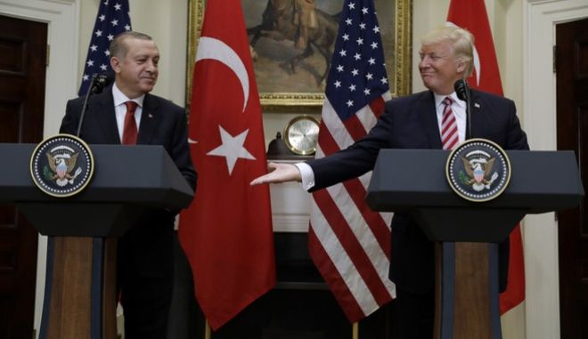 President Donald Trump reaches to shake hands with Turkish President Recep Tayyip Erdogan in the Roosevelt Room of the White House in Washington, Tuesday, May 16, 2017, where they made statements. (AP Photo/Evan Vucci)
