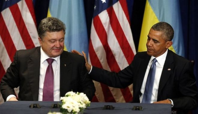 U.S. President Barack Obama meets with Ukraine President-elect Petro Poroshenko in Warsaw June 4, 2014. Obama promised on Tuesday to beef up military support for eastern European members of the NATO alliance who fear they could be next in the firing line after the Kremlin's intervention in Ukraine.  REUTERS/Kevin Lamarque  (POLAND - Tags: POLITICS)
