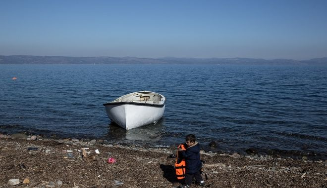Migrants and refugees arrive in a coast near Skala Sikaminias village in the north of Lesbos island, Greece on November 13, 2015.