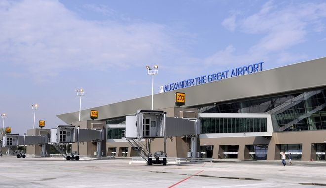 The picture shows passenger boarding bridges of the new terminal building of Alexander the Great Airport, near Macedonia's capital Skopje, during the official opening on Tuesday, Sept 6, 2011. The Turkish TAV Airports, that operates the airports in Macedonia, invested some 100 Million Euro (US$ 140 Million) in this new 40,000 square metre terminal building with 6 passenger boarding bridges, which will be able to handle a capacity of 4 million passengers per year. (AP Photo/Boris Grdanoski)