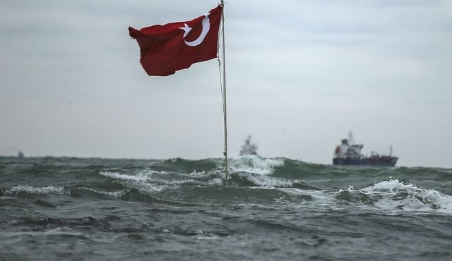 In this Saturday, Nov. 24, 2018 photo, a Turkish flag flies close to the beach, near the village of Kilyos, located in the Sariyer district of Istanbul, at the Black Sea, Turkey. (AP Photo/Emrah Gurel)