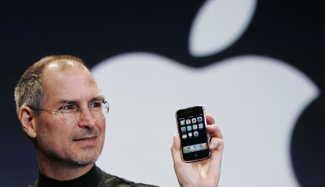 "FILE- In this Jan. 9, 2007, file photo, Apple CEO Steve Jobs holds up an iPhone at the MacWorld Conference in San Francisco. Jobs introduced the first iPhone a decade ago. Jobs' ""magical product"" reshaped culture, shook up industries and made it seem possible to do just about anything with a few taps on a screen while walking around with the equivalent of a computer in our pocket. (AP Photo/Paul Sakuma, File)"