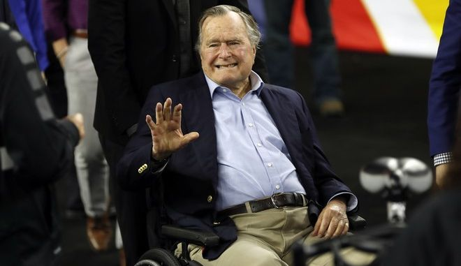 FILE -  In this April 2, 2016, file photo, former President George H. W. Bush waves as he arrives at NRG Stadium before the NCAA Final Four tournament college basketball semifinal game between Villanova and Oklahoma in Houston. Three years after shaving his head to show support for a toddler battling leukemia, Former President George H.W. Bush said on Twitter Nov. 21, 2016, that the same boy is feeling and doing much better.(AP Photo/David J. Phillip, File)