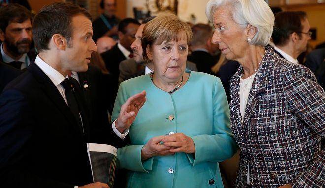 Ο Γάλλος Πρόεδρος Εμανουέλ Μακρόν, η Γερμανίδα Καγκελάριος Αγκελα Μέρκελ και η Διευθύντρια του ΔΝΤ Κριστιν Λαγκάρντ, το Μάιο του 2017