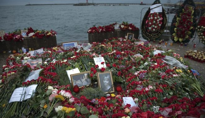 Flowers, candles and portraits are placed at a pier in honour of the victims of the military plane crash, in Sochi, Russia, in Sochi, Russia, Wednesday, Dec. 28, 2016. All 84 passengers and eight crew members on the Russian military's Tu-154 plane are believed to have died Sunday morning when it crashed two minutes after taking off from the southern Russian city of Sochi. (AP Photo/Viktor Klyushin)