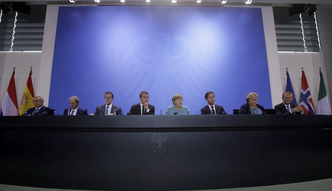 European Commission President Jean-Claude Juncker, Italian Prime Minister Paolo Gentiloni, Spain's Prime Minister Mariano Rajoy, France's President Emmanuel Macron, German Chancellor Angela Merkel, Mark Rutte, Prime Minister of the Netherlands, Norway's Prime Minister Erna Solberg and European Council President Donald Tusk, from left, attend a press conference after a gathering of European leaders on the upcoming G-20 summit in the chancellery in Berlin, Germany, Thursday, June 29, 2017. (AP Photo/Markus Schreiber)