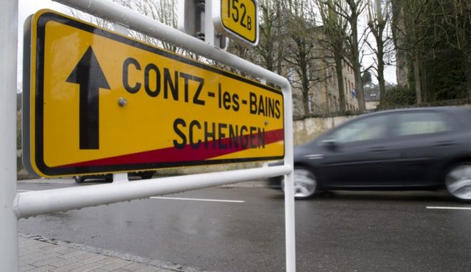 In this photo taken on Thursday, Feb. 4, 2016, a car drives out of Schengen, Luxembourg and into Contz-les-Bains, France. European Union countries are poised to reverse a decades-old trend of expanding passport-free travel by invoking an emergency rule to impose controls at several borders for two more years because of the migration crisis, according to European Union documents seen on Friday, Feb. 12, 2016. (AP Photo/Virginia Mayo)