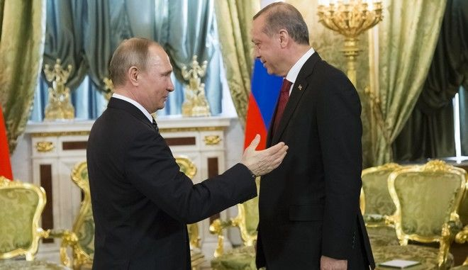 Russian President Vladimir Putin, left, speaks to Turkey's President Recep Tayyip Erdogan during their meeting in the Kremlin in Moscow, Russia, Friday, March 10, 2017. The talks focused on Syria, where Russia and Turkey have launched a joint mediation effort and coordinated their military action against the Islamic State group. (AP Photo/Alexander Zemlianichenko, pool)