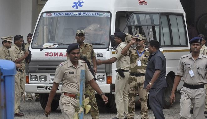 An ambulance carrying the body of Yakub Abdul Razak Memon stands at Dr Babasaheb Ambedkar airport as it waits to transport Memon's body to Mumbai from Nagpur, India, Thursday, July 30, 2015. Memon, 53, an Indian accountant and the only person sentenced to death for his role in the 1993 Mumbai bombings that killed 257 people  the country's worst terrorist attack  was hanged Thursday on his birthday, after the president rejected a last-minute mercy plea amid a debate over the capital punishment. (AP Photo)