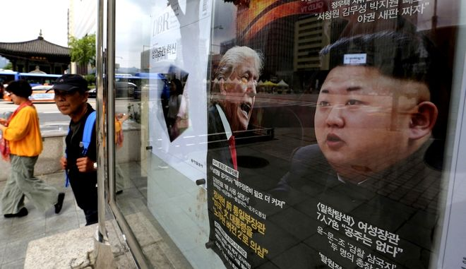 """A South Korean news magazine with front cover photos of U.S. President Donald Trump and North Korean leader Kim Jong Un, right, and a headline """"Korean Peninsula Crisis"""" is displayed at the Dong-A Ilbo building in Seoul, South Korea, Monday, Sept. 11, 2017. North Korea said it will make the United States pay a heavy price if a proposal Washington is backing to impose the toughest sanctions ever on Pyongyang is approved by the U.N. Security Council this week. (AP Photo/Ahn Young-joon)"""