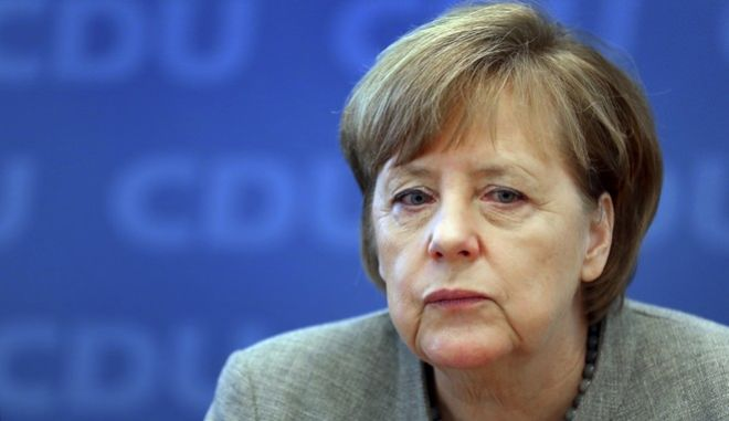 German Chancellor and Chairwoman of the German Christian Democratic Party (CDU), Angela Merkel, attends a party's board meeting in Berlin, Germany, Monday, Dec. 18, 2017. (AP Photo/Michael Sohn)