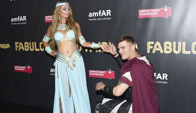 Socialite Paris Hilton, left, and boyfriend Chris Zylka attend the Fabulous Fund Fair, hosted by the Naked Heart Foundation and amfAR, at Skylight Clarkson North on Saturday, Oct. 28, 2017, in New York. (Photo by Evan Agostini/Invision/AP)