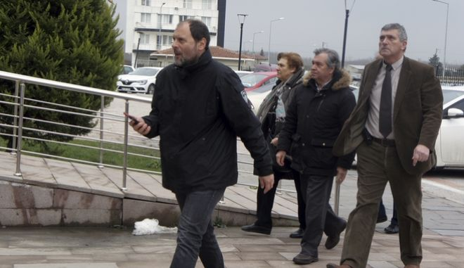 Parents of the arrested Greek soldiers, at center, arrive at the courthouse in Edirne, Turkey, Monday, March 5, 2018. The lawyers for two Greek soldiers arrested in Turkey have formally requested their release from custody. The two were arrested last week for allegedly entering a Turkish military zone and on suspicion of attempted espionage. (AP Photo/Ergin Yildiz)