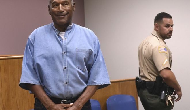 Former NFL football star O.J. Simpson enters for his parole hearing at the Lovelock Correctional Center in Lovelock, Nev., on Thursday, July 20, 2017.  Simpson was convicted in 2008 of enlisting some men he barely knew, including two who had guns, to retrieve from two sports collectibles sellers some items that Simpson said were stolen from him a decade earlier.   (Jason Bean/The Reno Gazette-Journal via AP, Pool)