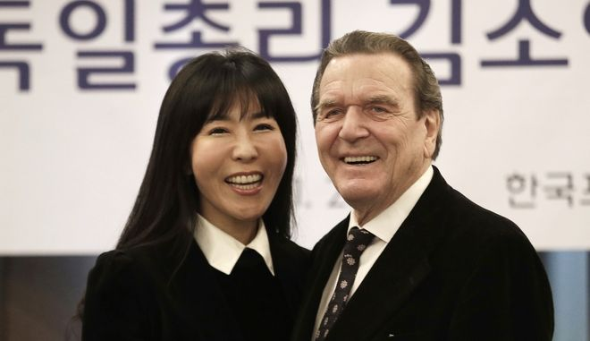 Former German Chancellor Gerhard Schroeder poses with his South Korean fiancee Kim So-yeon during a press conference in Seoul, South Korea, Thursday, Jan. 25, 2018. Yonhap News Agency said that they are going to marry around this autumn and that the exact venue and time have yet to be fixed. (AP Photo/Ahn Young-joon)
