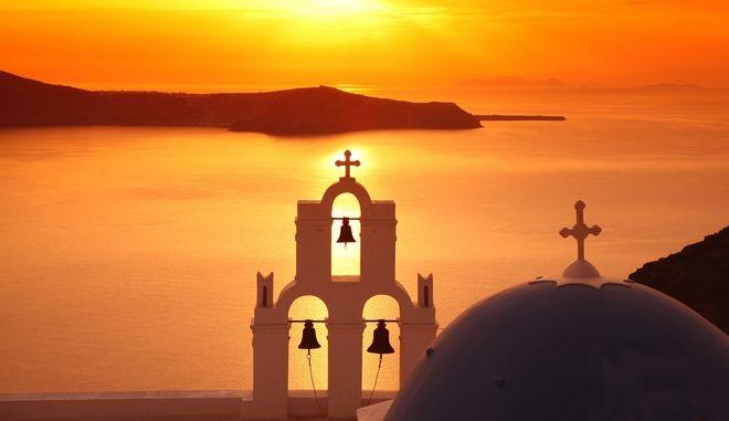13961678 - santorini with firostefani church against sunset over sea, fira, greece