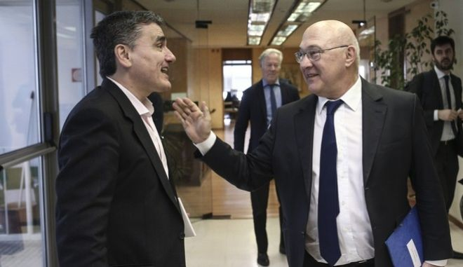 Meeting between the Greek Minister of Finance Euclid Tsakalotos and his French counterpart Michel Sapin, in Athens, on March 3, 2017 /             ,  ,  3 , 2017