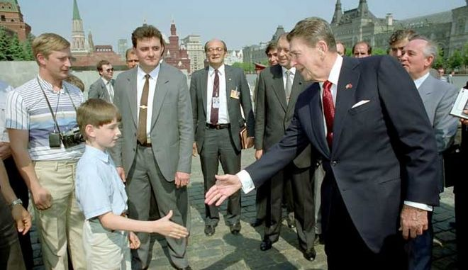 5/31/1988 President Reagan greets a young boy while touring Red Square during the Moscow Summit in the USSR