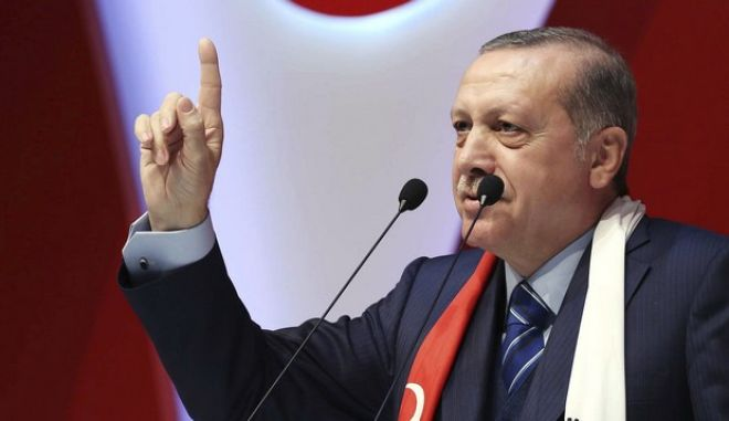 """Turkey's President Recep Tayyip Erdogan addresses a meeting in Istanbul, Saturday, March 4, 2017. Tensions flared between Ankara and Berlin on Friday over the cancellation of two Turkish Cabinet members' rallies in Germany, and the ongoing detention in Turkey of a German newspaper reporter. Delivering a speech in Istanbul, Erdogan accused the journalist working for Die Welt newspaper who was formally arrested last week of being a German spy as well as a """"representative"""" of the outlawed Kurdish rebel group, PKK.(Yasin Bulbul/Presidential Press Service, Pool Photo via AP)"""