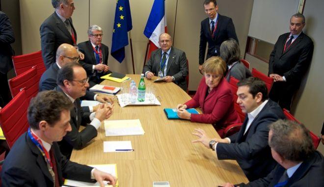 Τριμερής συνάντηση του πρωθυπουργού Αλέξη Τσίπρα με τον πρόεδρο της Γαλλικής Δημοκρατίας, Φρανσουά Ολάντ και την καγκελάριο της Ομοσπονδιακής Δημοκρατίας της Γερμανίας, Άγκελα Μέρκελ στις Βρυξέλλες, στο περιθώριο της Συνόδου  εργασίας Ευρωπαϊκού Συμβουλίου με την Τουρκία για το προσφυγικό, Πέμπτη 17 Μαρτίου 2016. (EUROKINISSI/ΕΥΡΩΠΑΪΚΗ ΕΝΩΣΗ)
