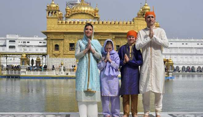 CORRECTS THE NAME OF THE IMAGE PROVIDER Canadian Prime Minister Justin Trudeau, right, his wife Sophie Gregoire Trudeau, left, their daughter Ella Grace, second left, and son Xavier greet in Indian style during their visit to Golden Temple, in Amritsar, India, Wednesday, Feb. 21, 2018. Trudeau is on a seven-day visit to India. (Public Relations Office Govt. Of Punjab via P)