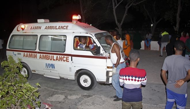 Relatives and medical staff wait by arriving ambulances at Medina hospital, following a twin car bomb attack in the capital Mogadishu, Somalia Friday, Feb. 23, 2018. Two car bomb blasts rocked Somalia's capital on Friday evening, followed by gunfire, police said, and an ambulance service said more than a dozen had been killed and many injured, with responsibility claimed by the Somalia-based extremist group al-Shabab. (AP Photo/Farah Abdi Warsameh)