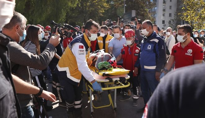 Medics and rescue personnel carry an injured person from the debris of a collapsed building in Izmir, Turkey, Saturday, Oct. 31, 2020. Rescue teams on Saturday ploughed through concrete blocs and debris of eight collapsed buildings in Turkey's third largest city in search of survivors of a powerful earthquake that struck Turkey's Aegean coast and north of the Greek island of Samos, killing dozens Hundreds of others were injured. (AP Photo/Darko Bandic)