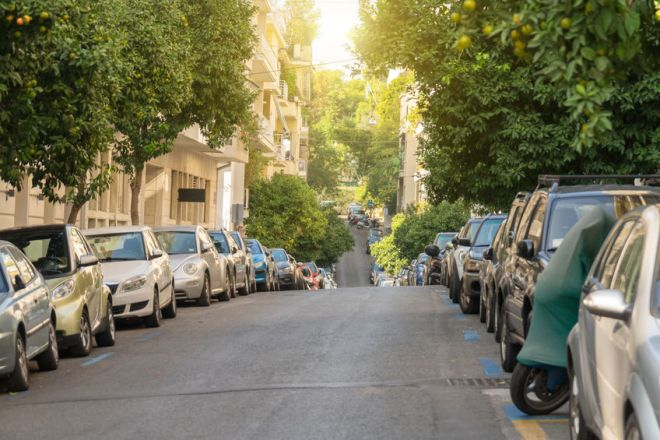 Cars parked along the street in Athens.