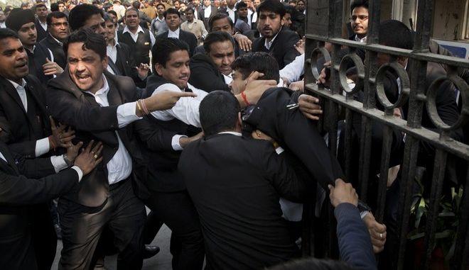 (AP Photo/Tsering Topgyal)
