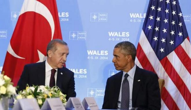 U.S. President Barack Obama listens as he hosts a bilateral meeting with Turkey's President Tayyip Erdogan during the NATO Summit at the Celtic Manor Resort in Newport, Wales September 5, 2014.      REUTERS/Larry Downing   (UNITED KINGDOM - Tags: POLITICS) *** Local Caption *** NATO ZIRVESINDE BIR ARAYA GELEN ABD BASKANI BARACK OBAMA VE CUMHURBASKANI RECEP TAYYIP ERDOGAN