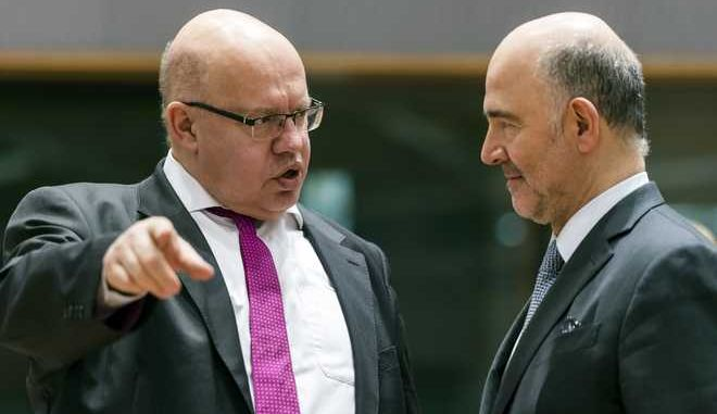 Germany's acting Finance Minister Peter Altmaier, left, talks with EU Commissioner for Economic and Financial Affairs, Taxation and Customs Pierre Moscovici during an Eurogroup finance ministers meeting at the EU Council in Brussels on Monday, Jan. 22, 2018. (AP Photo/Geert Vanden Wijngaert)