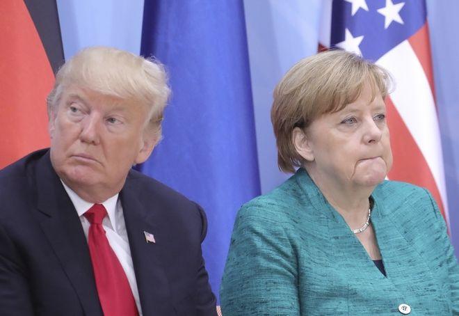 US President Donald Trump and  German Chancellor Angela Merkel attend a panel session at the G20 summit in Hamburg, Germany, Saturday, July, 8, 2017. (Michael Kappeler/Pool Photo via AP)