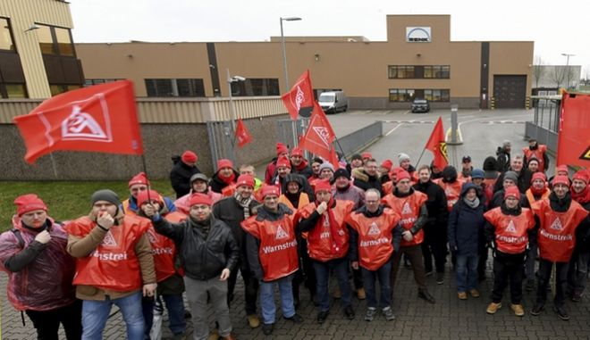 Metal workers gather during a warning strike at Renk AG company in Hannover, Germany, Wednesday, Jan. 31, 2018. Germany's biggest industrial union has launched a campaign of 24-hour strikes after talks on demands for wage raises and an optional shorter working week broke down. (Holger Hollemann/dpa via AP)