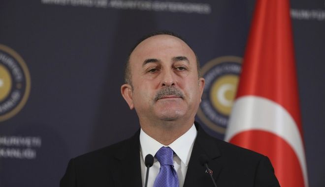Turkey's Foreign Minister Mevlut Cavusoglu, listens during a joint news conference with U.S. Secretary of State Rex Tillerson, following their meeting in Ankara, Turkey, Friday, Feb. 16, 2018. The talks in Ankara were to focus on Washington's plan to continue providing the Kurdish militants assistance and Turkey's military operation in a Syrian Kurdish-controlled enclave in northern Syria, that had caused some of the worst tensions in years between the two NATO allies. (AP Photo/Burhan Ozbilici)