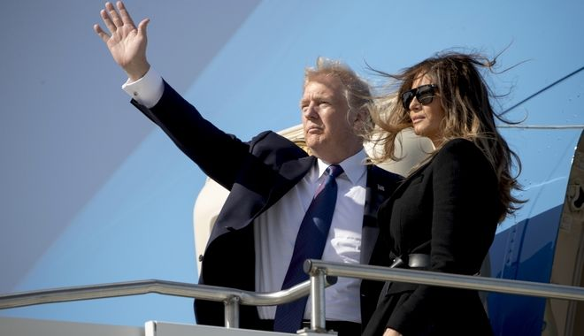 U.S. President Donald Trump and first lady Melania Trump board Air Force One at Osan Air Base in Pyeongtaek, South Korea, Wednesday, Nov. 8, 2017, to travel to Beijing. Trump is on a five-country trip through Asia traveling to Japan, South Korea, China, Vietnam and the Philippines. (AP Photo/Andrew Harnik)