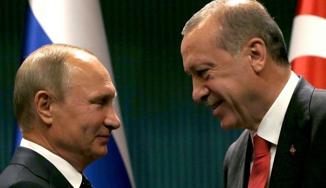 Turkey's President Recep Tayyip Erdogan, right, shakes hands with Russian President Vladimir Putin after a news conference and their meeting in Ankara, Turkey, Thursday, Sept. 28, 2017. Russian President Vladimir Putin is Ankara for talks with Erdogan on developments in Iraq and Syria, and Turkey's decision to purchase a Russian-made missile defense system. (AP Photo/Burhan Ozbilici)